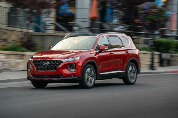 side view of a red 2019 Hyundai Santa Fe