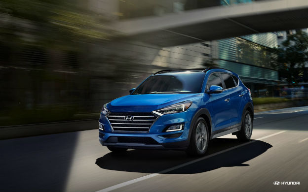 front view of a blue 2019 Hyundai Tucson