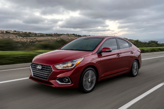 side view of a red 2020 Hyundai Accent