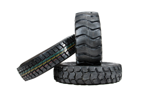 A variety of differently sized tires lean against one another, wondering which is to be chosen and why.